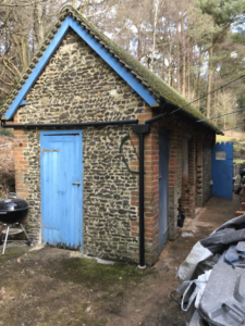 Outhouse with blue doors