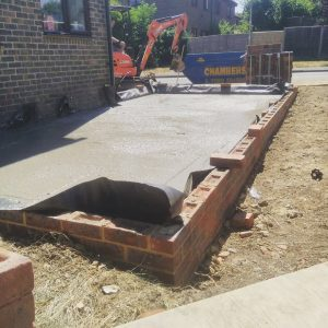 Image of the concrete laid out within the brickwork for the Odiham project