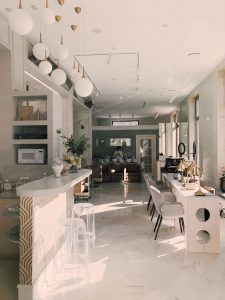 A white, marble kitchen, designed and built by residential developers.