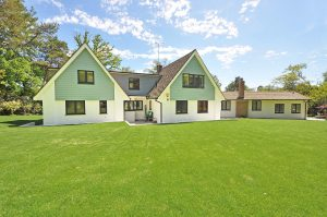 detached home with converted garage on side