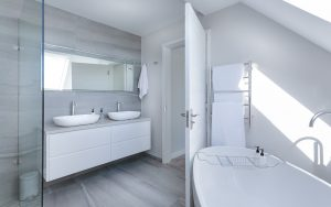 A photo of a contemporary grey and white bathroom