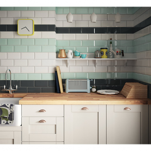 A photo of a kitchen work top with white, green and black tiles