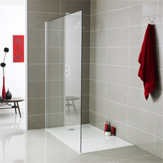 An image of a modern bathroom with matching red accessories