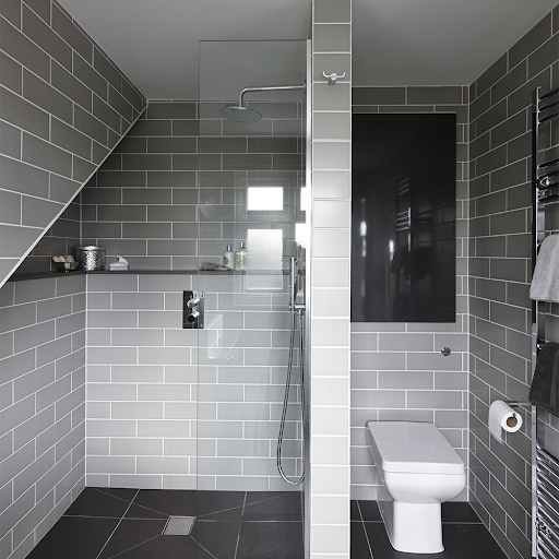 An image of a stylish grey tiled bathroom