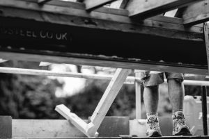 Builder at work in black & white